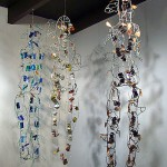 Marita Dingus hanging figures at Francine Seders Gallery photo by liesel lund