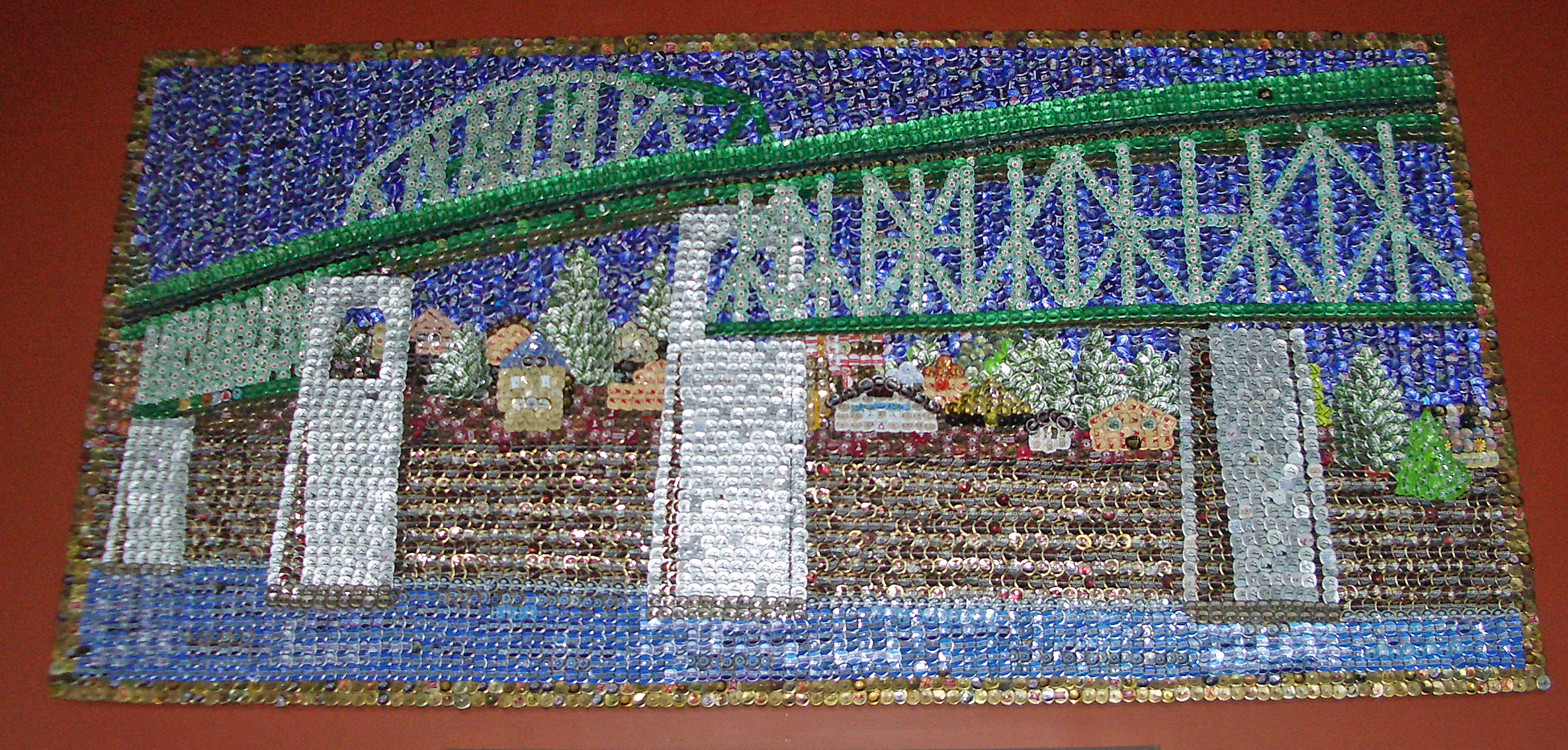 Recycle art bremerton wa ruby re usable for Bottle cap mural tutorial