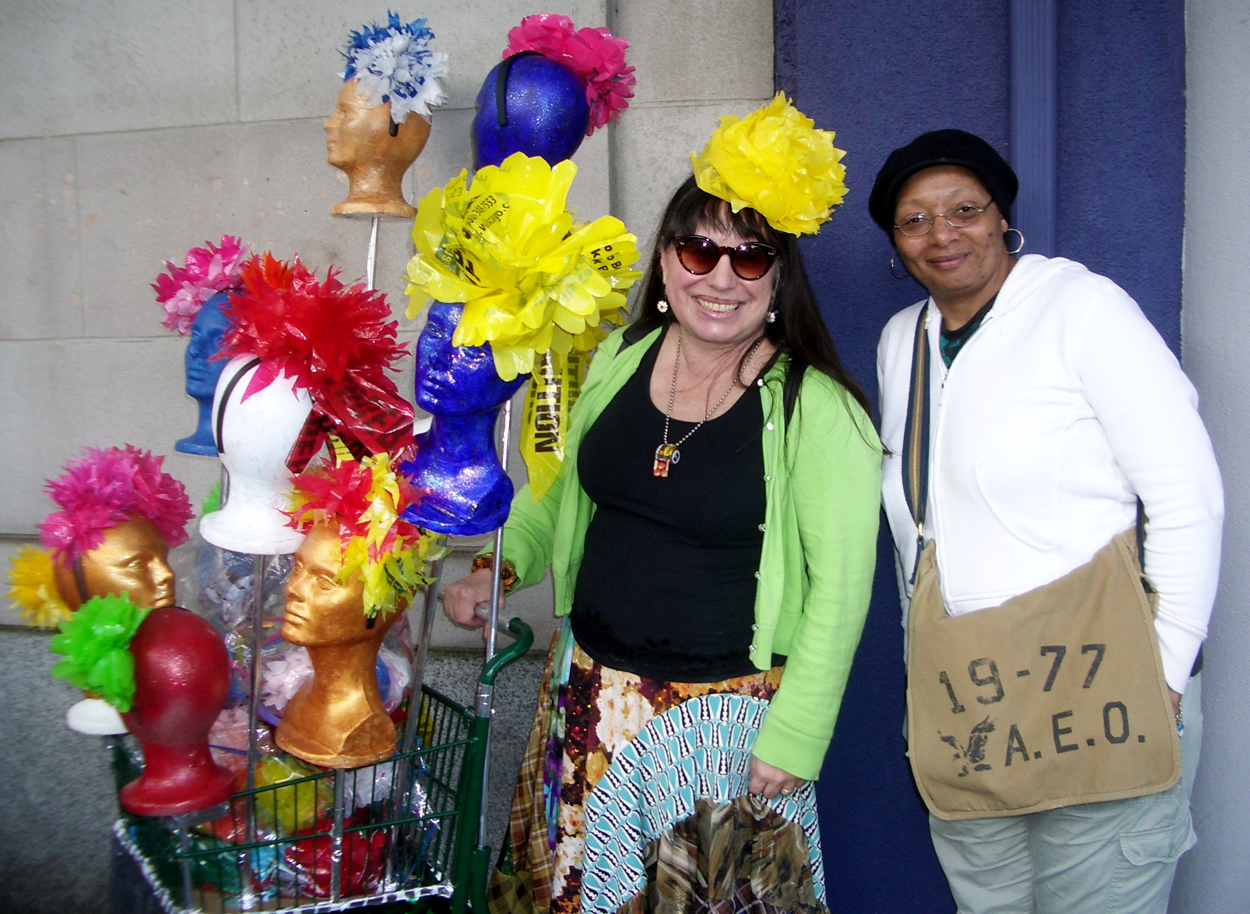 Ruby Re-Usable (w/friend Linda C) and her shopping cart of repurposed plastic bag flower fascinators