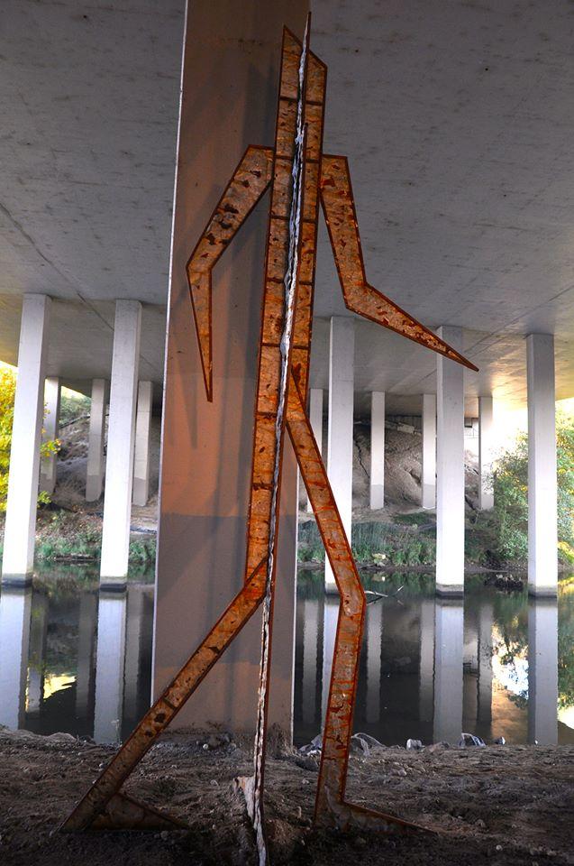 Guerrilla Man sculpture underneath I-5
