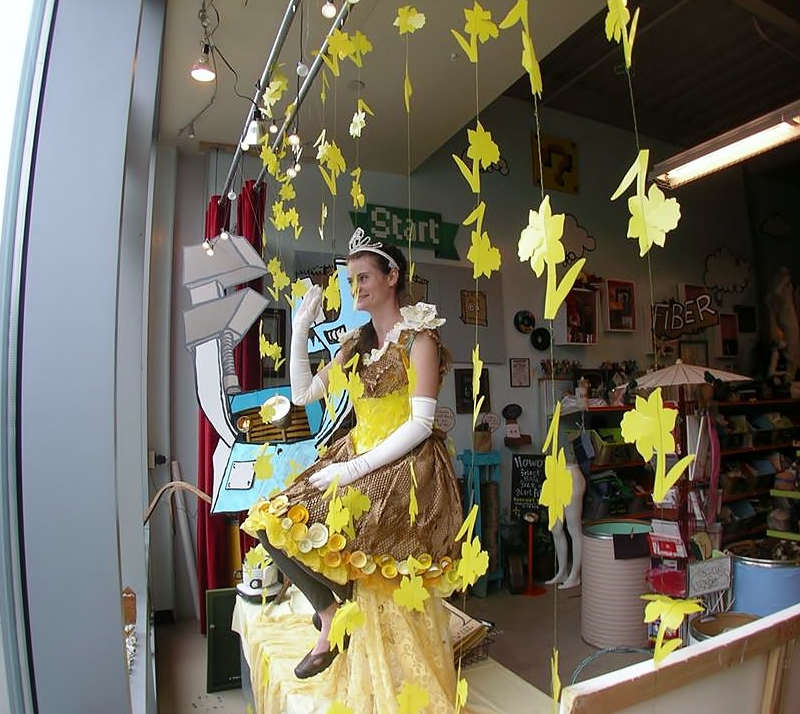 Ms Darcy as a Daffodil Princess in the window of Tinkertopia