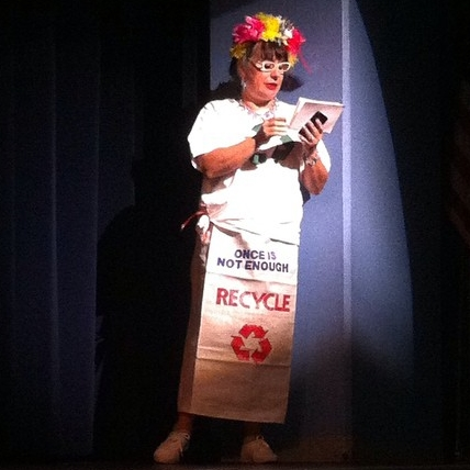 """Ruby wearing a bag from Mason County recycling that reads """"Once Is Not Enough"""""""