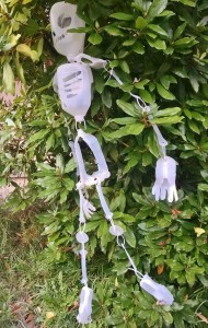 plastic jug skeleton in tree
